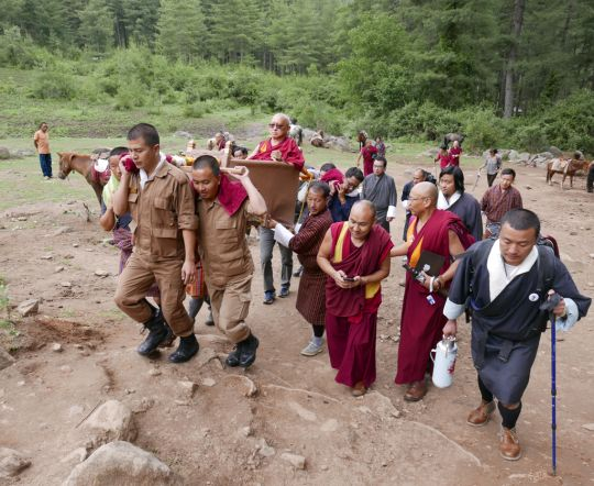 Lama Zopa Rinpoche in a palanquin, beginning the pilgrimage to Tiger's Nest Monastery, Bhutan, May 2016. Photo by Ven. Roger Kunsang.