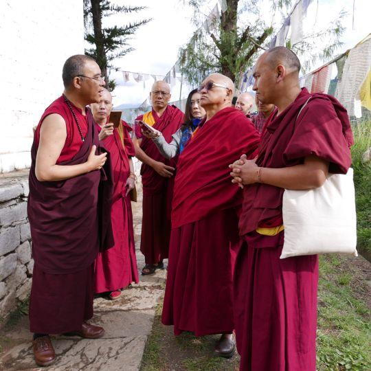 Lama Zopa Rinpoche listening to KhenpoPhuntsokTashias he describes the details of the holy site, Bhutan, May 2016. Photo by Ven. Roger Kunsang.