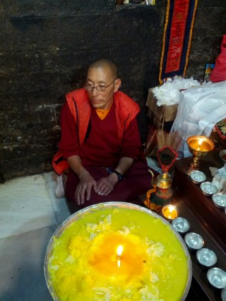The butter lamp offered to the self-emanating Chenrezig statue will burn as long as the statue remains.