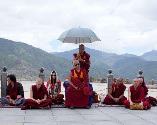 Lama Zopa Rinpoche doing prayers in front of Buddha statue in Thimbu, Bhutan, June 2016. Photo by Ven. Lobsang Sherab.