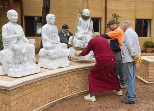 Thubten Gyatso and others install marble statues of the 18 Arhats, Thubten Shedrup Ling Monastery, Myers Flat, Australia, May 2016. Photo courtesy of Thubten Shedrup Ling.