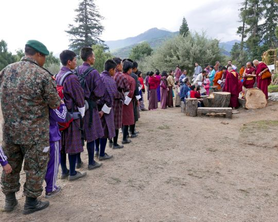 The line became longer and longer to receive blessings from Lama Zopa Rinpoche at the flower show, Paro, Bhutan, June 2016. Photo by Ven. Roger Kunsang.