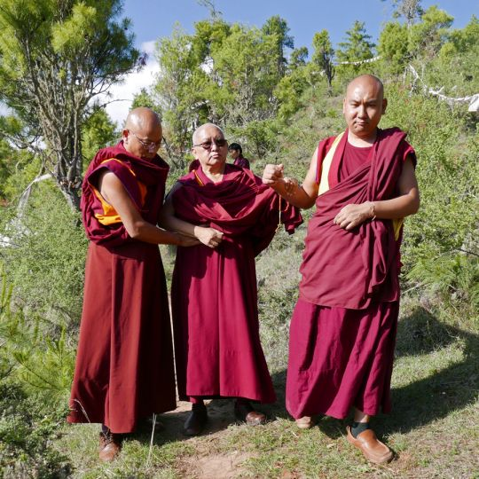 Lama Zopa Rinpoche with Geshe Tenzin Khenrab (left) and Ven. Tendar walking down to  Drakarpo in Paro, Bhutan, June 2016. Photo by Ven. Roger Kunsang.