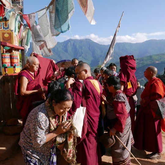 Lama Zopa Rinpoche offering blessing strings and Namgyalma protections at Drakarpo, Bhutan, June 2016