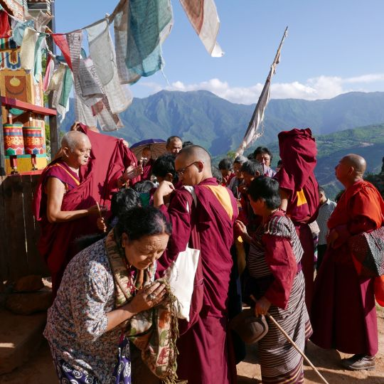 Lama Zopa Rinpoche offering blessing strings and Namgyalma protections at Drakarpo, Bhutan, June 2016