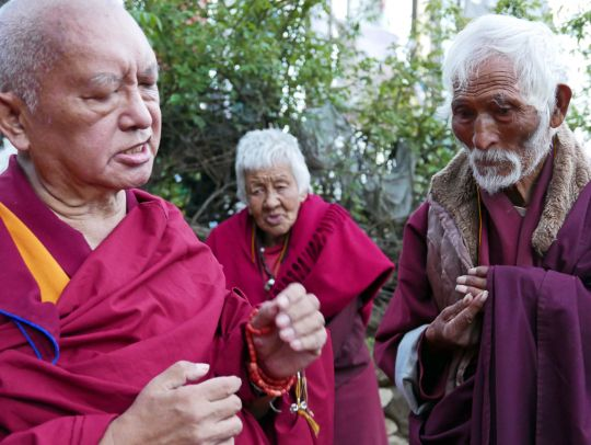 Lama Zopa Rinpoche gives a teaching on the importance of ones motivation to yogi meditators he met at Drakarpo, the holy site of Guru Rinpoche's body in Paro, Bhutan