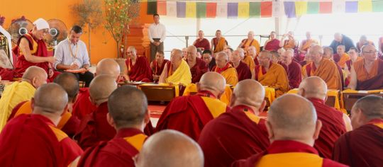 His Holiness the Dalai Lama addressing Lama Zopa Ripoche and an audience of geshes and Sangha, during his visit to Italy in June 2014. His Holiness has a white cloth on his head because the weather was very warm. Photo by Ven. Thubten Kunsang.