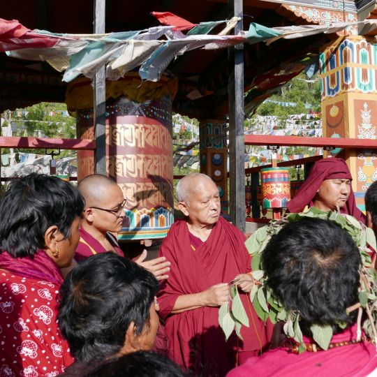 Lama Zopa Rinpoche offering blessing strings and Namgyälma protections at Drakarpo, the holy site of Guru Rinpoche's body, Paro, Bhutan, June 2016. Photos by Ven. Roger Kunsang.