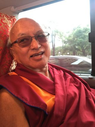 Lama Zopa Rinpoche on the way to airport, Taiwan, June 2016. Photo by Ven. Roger Kunsang.