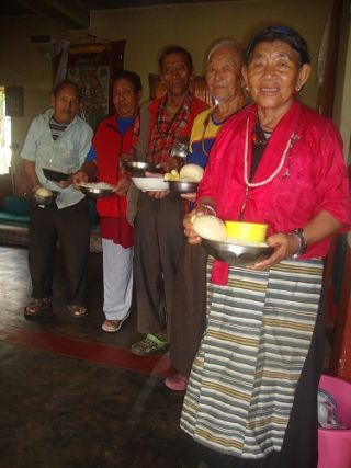 Members of the elderly home at Rabagayling Tibetan Settlement are offered food through a grant from the Social Services Fund.