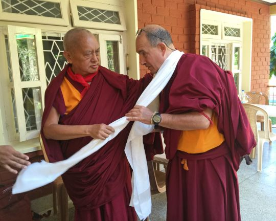 Lama Zopa Rinpoche offering Ven. Thubten Kunsang a khata blessed by His Holiness the Dalai Lama for Ven. Kunsang, Sera Monastery, India, January 2016. Photo by Ven. Roger Kunsang.