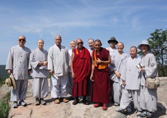 Lama Zopa Rinpoche and his attendant Ven. Sangpo Sherpa with a group of Korean monks and nuns  on top of Bear Mountain, New York, July 2016. Photo by Ven. Lobsang Sherab.