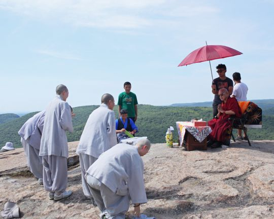 Korean monks and nuns making prostrations to Lama Zopa Rinpoche on top of Bear Mountain, New York, July 2016. Photo by Ven. Lobsang Sherab.