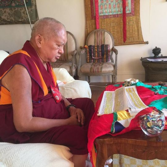 Lama Zopa Rinpoche reciting Arya Sanghata Sutra for Ven. Kunsang, July 2016. Photo by Ven. Roger Kunsang via Twitter.