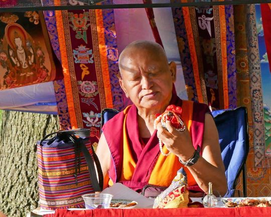 Lama Rinpoche giving advice at a picnic organized by Shantideva Center in a park next to the Hudson River in New York City. Rinpoche explained about the ancient Tara statue that he always carries with him, which he had in his previous life and kept all the time with him, August 2016. Photo by Roger Kunsang.