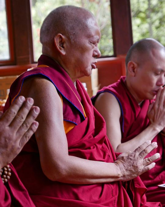 Lama Zopa Rinpoche doing puja on the way to Taktsang (Tiger's Nest) Monastery, Bhutan, May 2016. Photo by Ven. Roger Kunsang.