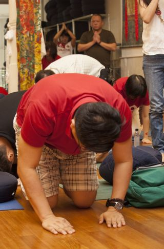 Students prostrating, Amitabha Buddhist Centre, Singapore, August 2015. Photo courtesy of ABC.