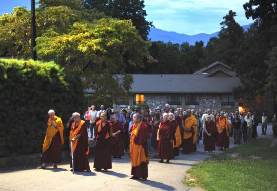Lama Zopa Rinpoche leading students in a walking meditation at the Light of the Path Retreat, North Carolina, US, August 2016. Photo by Ven. Lobsang Sherab.