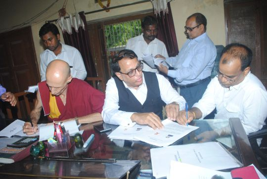Maitreya Project Trust Chairperson Ven.Kabir Saxena, Special Secretary deputed by Uttar Pradesh State Government Mr. Surya Mani Lalchand and Maitreya Project Trust legal advisor Advocate Atul Chopra signing the papers for the transfer of land, India, August 19, 2016. Photos courtesy of the Maitreya Buddha Project Kushinagar.