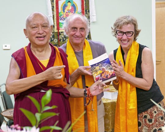 Lama Zopa Rinpoche with Nicholas Ribush and Wendy Cook of the Lama Yeshe Wisdom Archive, Black Mountain, North Carolina, US, August 2016. Nick and Wendy are presenting Rinpoche with a copy of Rinpoche's new book Sun of Devotion, Stream of Blessings, just published by the Archive. Photo by Ven. Roger Kunsang.