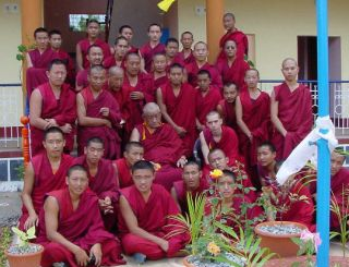 Teenage Tenzin Ösel Hita with the monks at Sera Je Monastery.