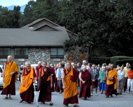 Lama Zopa Rinpoche leading walking meditation at Light of the Path, Black Mountain, North Carolina, US, August 2016. Photo by Ven. Lobsang Sherab.
