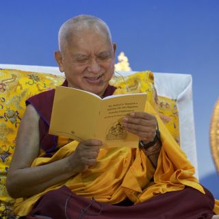 Lama Zopa Rinpoche reading from The Method to Transform a Suffering Life into Happiness, April, 2016. Photo by Bill Kane.