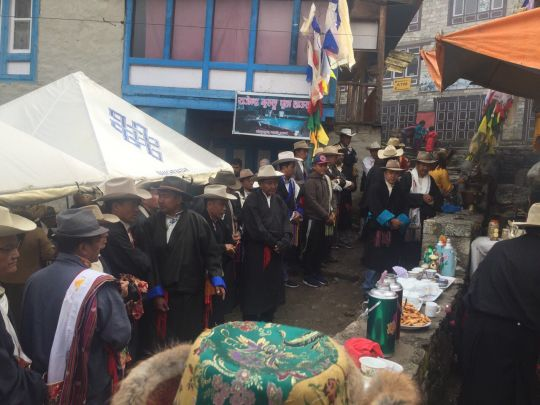 Locals gather for a puja at the site of the new prayer wheel and water park.