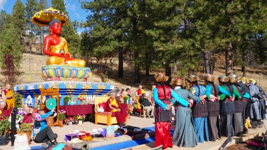 Lama Zopa Rinpoche watches the Sherpa dance offering