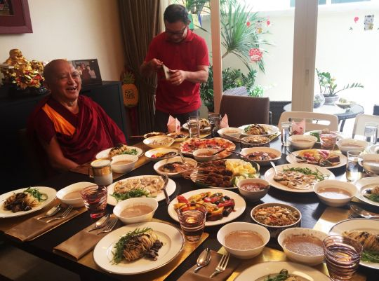 Lama Zopa Rinpoche prepares for a party in Singapore, February 2016.