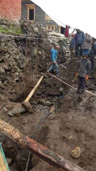 Laying the foundation for the new gompa.