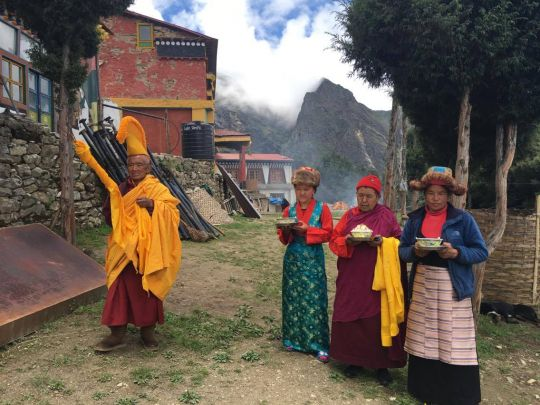 Greeting the large Guru Rinpoche statue arriving at Lawudo with ___.
