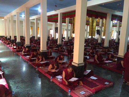 In addition to debate, the monks are required to pass a written examination.