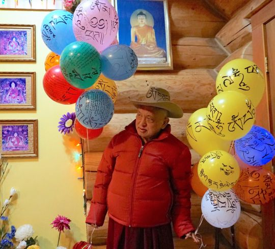 Lama Zopa Rinpoche with balloons covered with mantras, Washington State, USA, November 2016.  Photo by Ven. Lobsang Sherab.