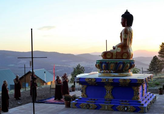 Lama Zopa Rinpoche and Sangha make prayers in front of the Buddha Amitabha statue at Buddha Amitabha Pure Land, Washington State, US, September 2016. Photo by Ven. Lobsang Sherab.