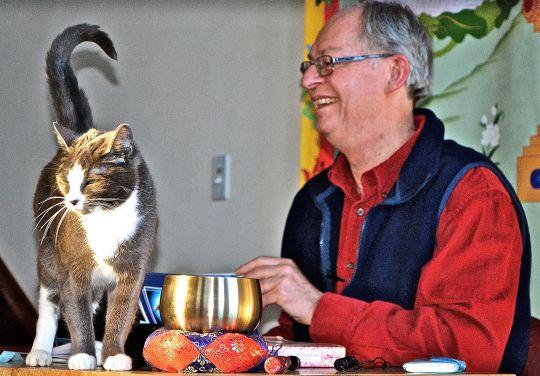 Dr. Roger Jackson gives Dharma teachings to Maitri the cat and others at Sravasti Abbey, February 2016. Photo courtesy of Sravasti Abbey.