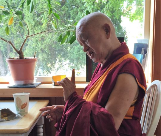 Lama Zopa Rinpoche gives an impromptu Dharma teaching in a coffee shop to two people who approached him, an act that demonstrated his stated wish to make every moment beneficial by teaching the Dharma, Washington State, USA, November 2016. Photo by Ven. Roger Kunsang.