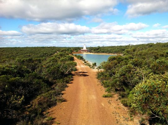 View of De-Tong Ling's stupa and dam surrounded by pristine Australian bush. Photo by Center Director Will Abram.
