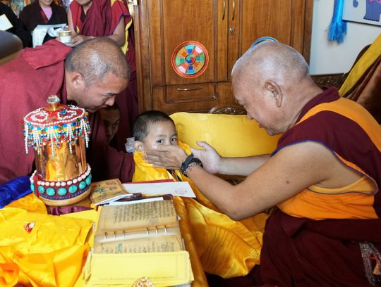 Lama Zopa Rinpoche meeting the reincarnation of Khensur Rinpoche Lama Lhundrup, Tenzin Rigsel, for the first time. Kopan Monastery, November 2016. Photo by Ven. Lobsang Sherab.