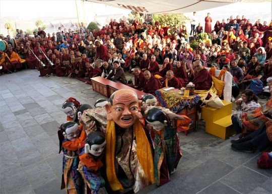 Lama Zopa Rinpoche watches a lama dance at the picnic after his long life puja. Kopan Monastery, Nepal, December 2016. Photo by Ven. Lobsang Sherab.