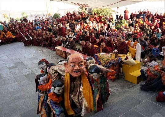 Lama Zopa Rinpoche watches a lama dance at the picnic after his long life puja. Kopan Monastery, Nepal, December 2016. Photo by Ven. Lobsang Sherab.