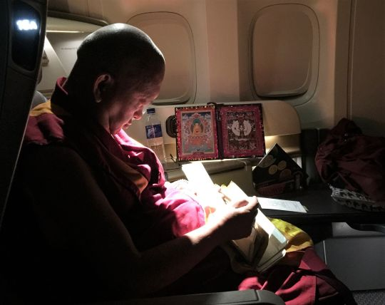 Lama Zopa Rinpoche traveling by air, 2016.
