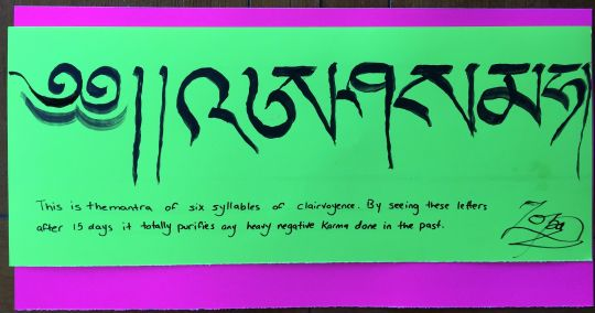 The mantra of the six syllables of clairvoyance, written by Lama Zopa Rinpoche. Rinpoche asked for this sign to be displayed indoors and outdoors to leave imprints on the beings that see it. Washington State, USA, 2016. Photo by Ven. Roger Kunsang.