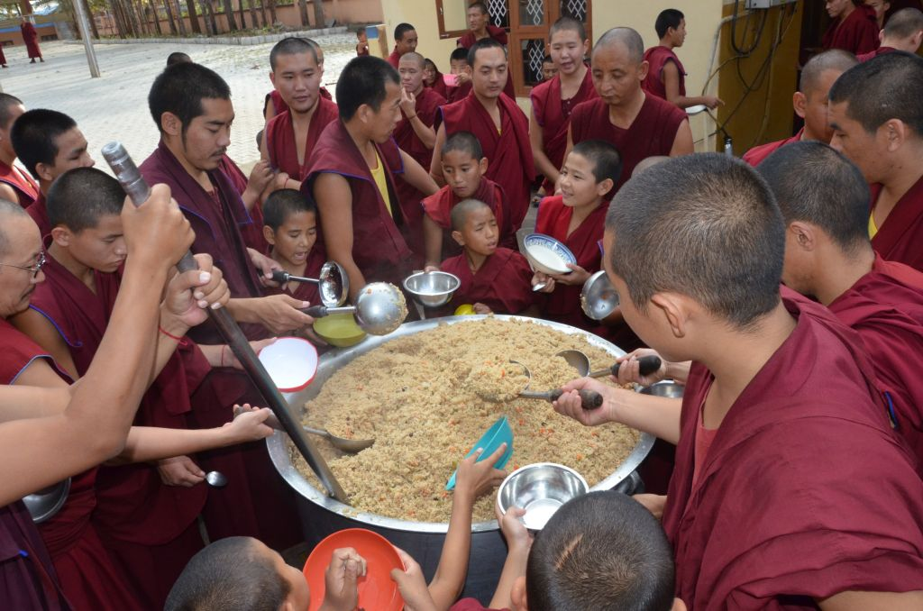 Monks of Sera Je Monastery serving food offered by the Sera Je Food Fund.
