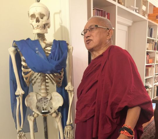 Lama Zopa Rinpoche recites mantras to bless a skeleton, New York, USA, August 2016