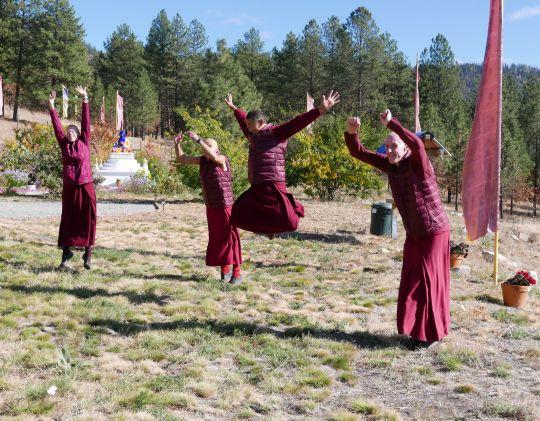 Sangha jumping for joy at Buddha Amitabha Pure Land, Washington State, USA, November 2016. Photo by Ven. Roger Kunsang.
