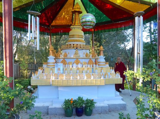 Lama Zopa Rinpoche circumambulating a stupa at KachoeDechenLing,Aptos, California, November, 2016.  Photo by Ven. Losang Sherab.