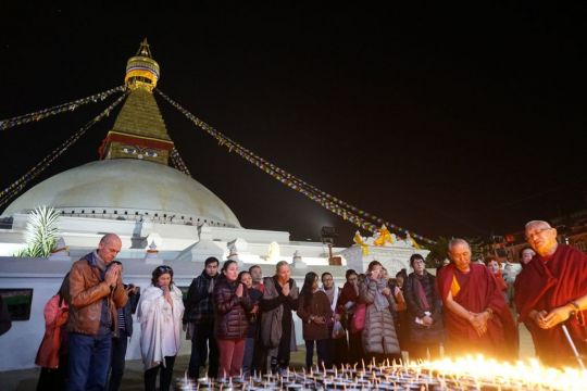 Light offerings at Boudhanath Stupa at night, with Khen Rinpoche and Lama Zopa Rinpoche, December 2016. Photo by Ven. Sherab.
