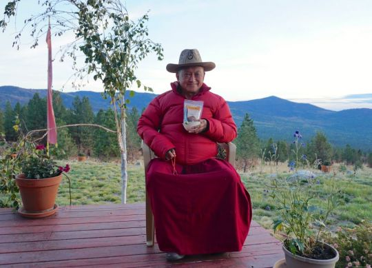 Lama Zopa Rinpoche wearing his mantra hat and holding tea offered to him by Kunsang Yeshe Retreat Centre in the Blue Mountains in Australia. Washington State, USA. November 2016. Photo by Ven. Lobsang Sherab.