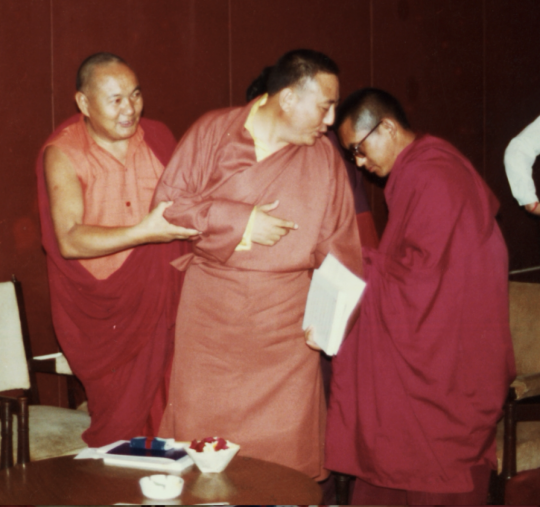 Lama Yeshe and Lama Zopa Rinpoche pushing Gelek Rinpoche into the top seat. Photo courtesy of Lama Yeshe Wisdom Archive.